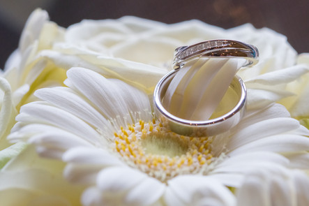 Wedding rings on the brides flowers.