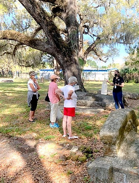 Krystin giving tour in cemetery March 2021 near Tresca graves_edited_edited.jpg