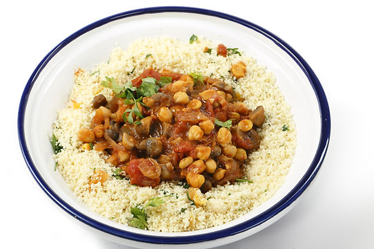 Chickpeas or garbanzo beans and quartered button mushrooms cooked in a spicy tomato and on