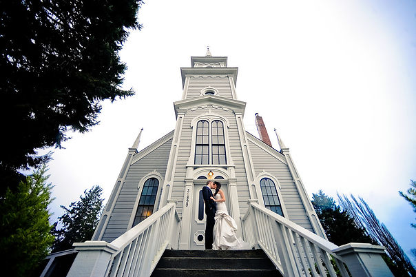 These newlyweds enjoyed a kiss after their traditional ceremony at St. Paul's Church, built in 1879. Photo by Jerome Tso Photography