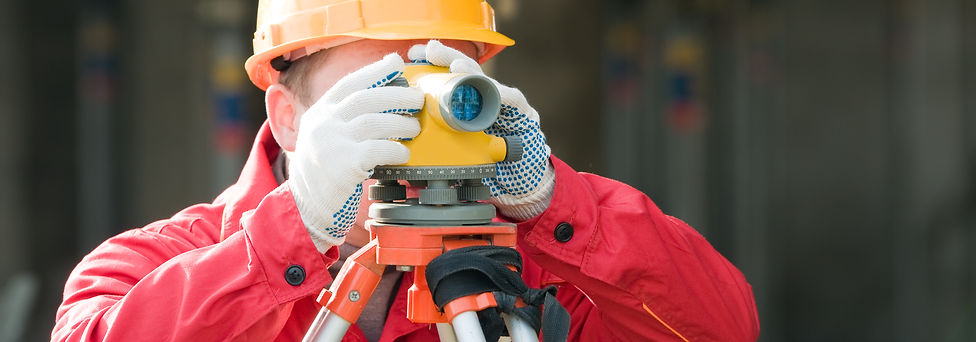 builder surveyor working with optical eq