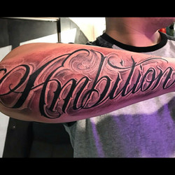 Ambition Arm Tattoo