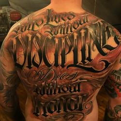 Discipline Back Tattoo