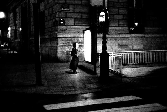 Woman looking at a lit map, Paris 2000.j