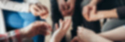 close-up-of-hands-of-people-sitting-in-a
