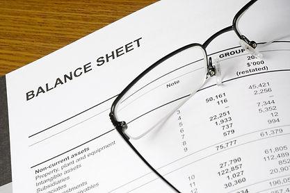 Balance sheet and glasses