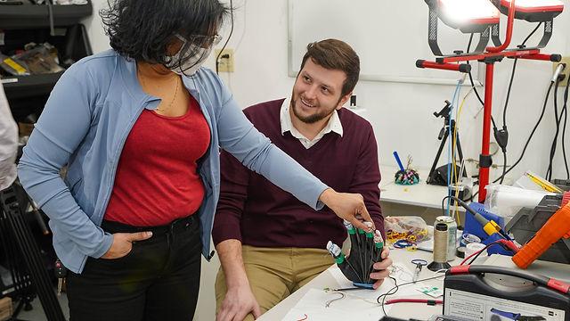 Professor Trisha Andrew and engineer Michael Richared working on heated gloves