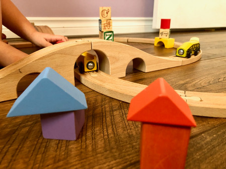 We love playing with our wood blocks and IKEA train set!