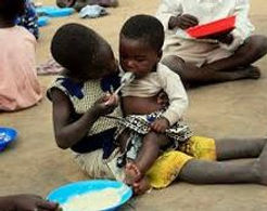 feeding children.JPG
