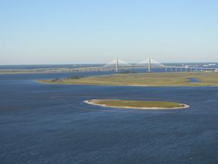 Photo Release: Responders install boom around Bird Island