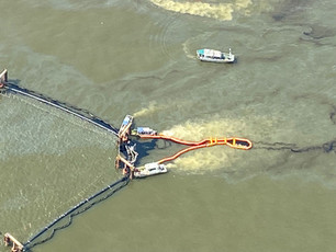 Pollution response teams mitigate oil discharge