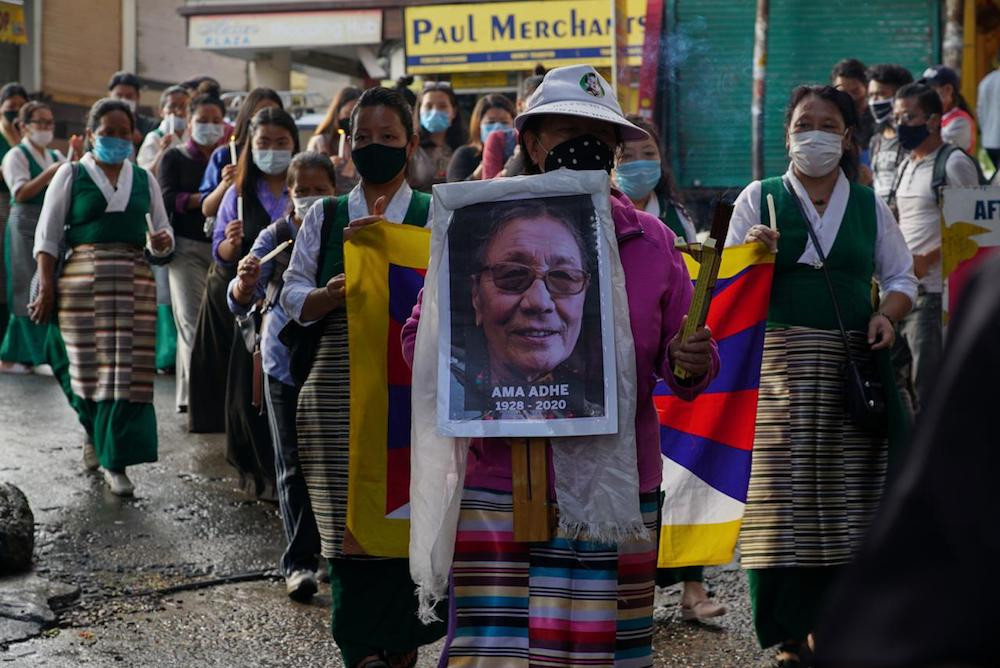 SFT and TWA activists hold a vigil in memory of Ama Adhe at McLoed Ganj on August 3, 2020 (Photo by Tenzin Leckphel)