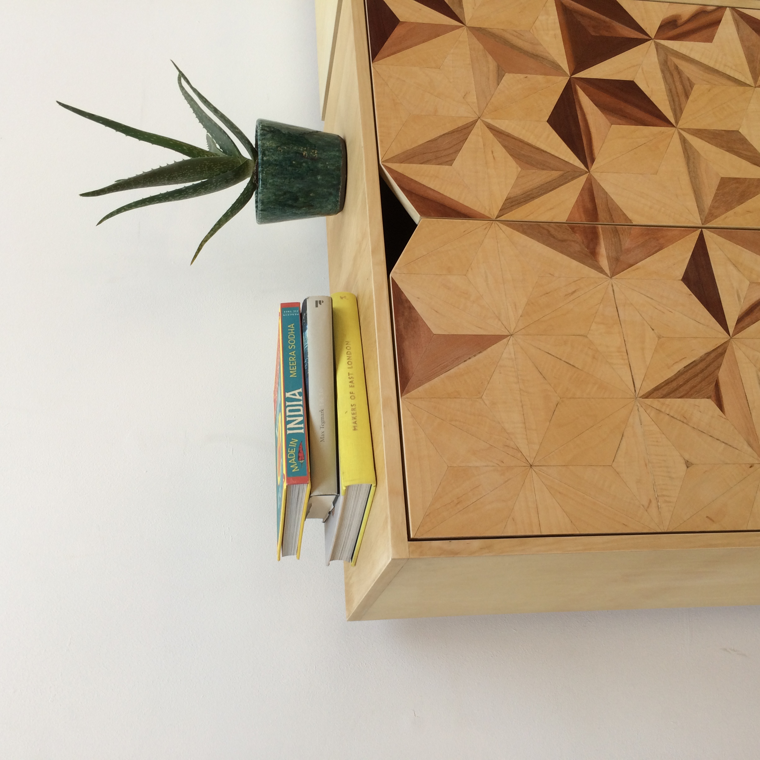 Geometric inlay cabinets