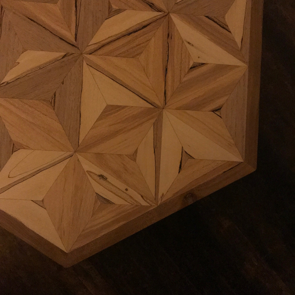 Hand crafted solid elmcoffee table with spalted beech geometric inlaid tabletop