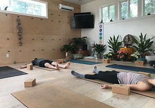 people are practicing yoga at yoga studio
