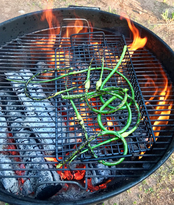 I LOVE garlic scape season! My favorite preparation is on the grill.