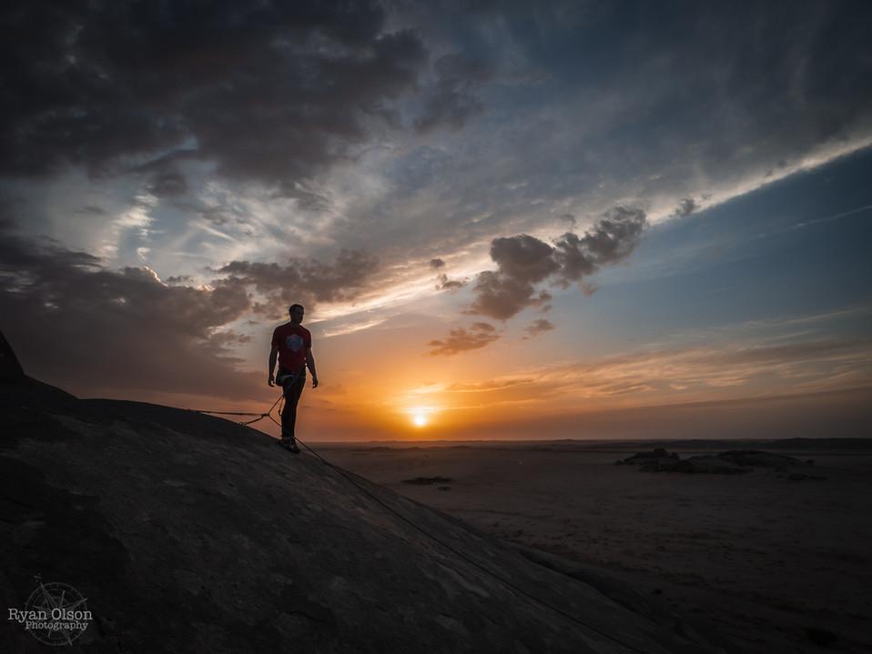 Ben Nelson climbing near Umm Sarayha, Saudi Arabia