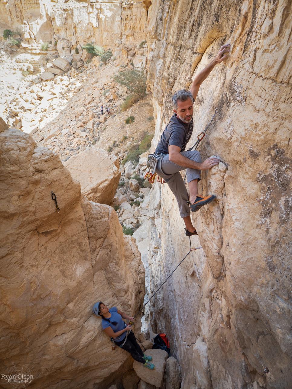 "Joao Miguel climbing ""Al Mahar"" 7a in Wadi Al Akhu, Saudi Arabia"