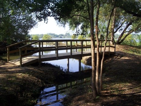 Thanks to Marty Tackett, Rick Huffman, Gene Stoneburner, Jim Young, Greg Hoffmann, and Tom Root for designing and building the a new foot bridge at Cypress Cove Park in September, 2003. The funding came from the City of Irving's Community Partnership Fund.
