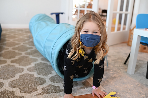 Child in tuquise tube.png