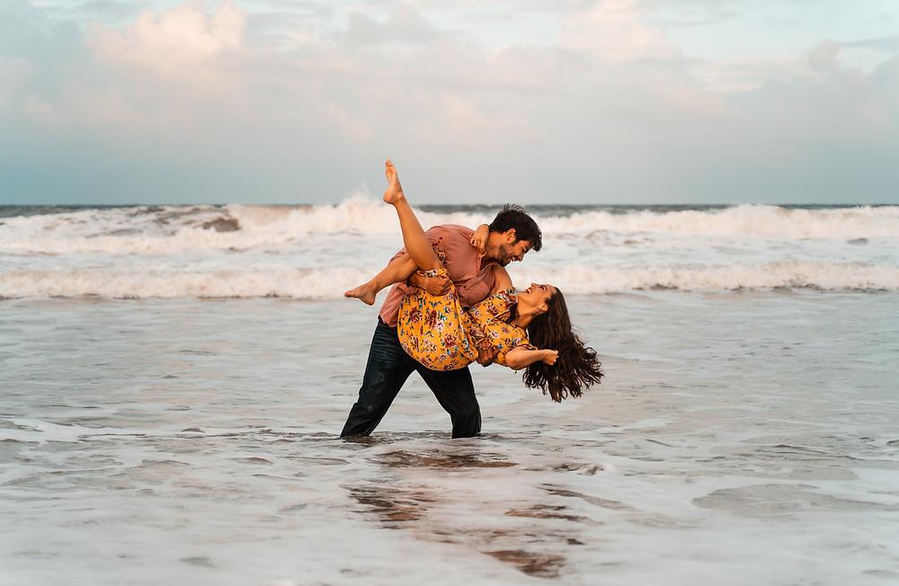 Enagement photos shoot in the ocean waves. Atlantic Beach Florida.