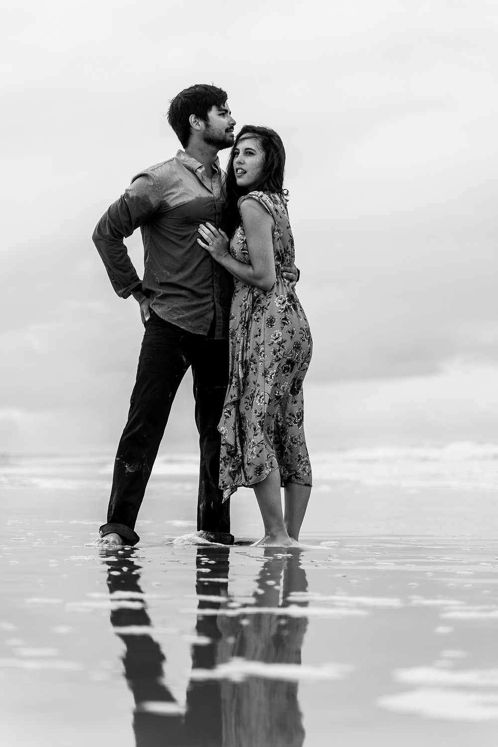 Sexy couple on the beach in North East Florida during an enagement photo shoot.