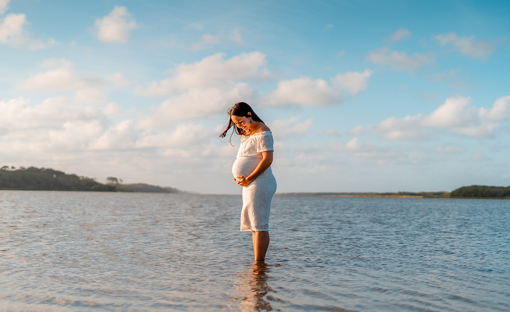 Maternity shoot in the water.