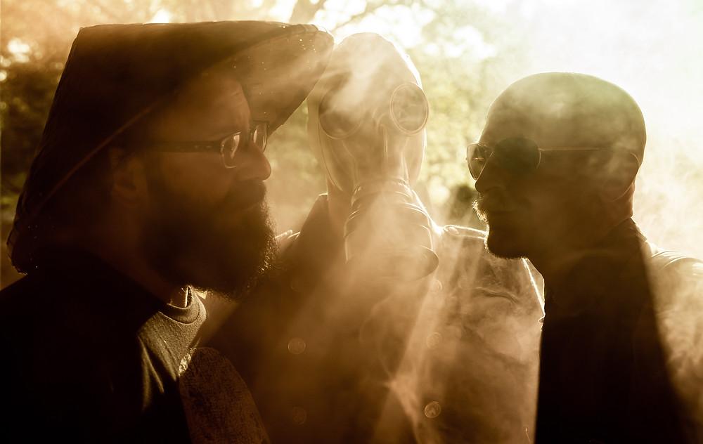 Sun rays through smoke. Offbeat wedding with smoke bomb photography.