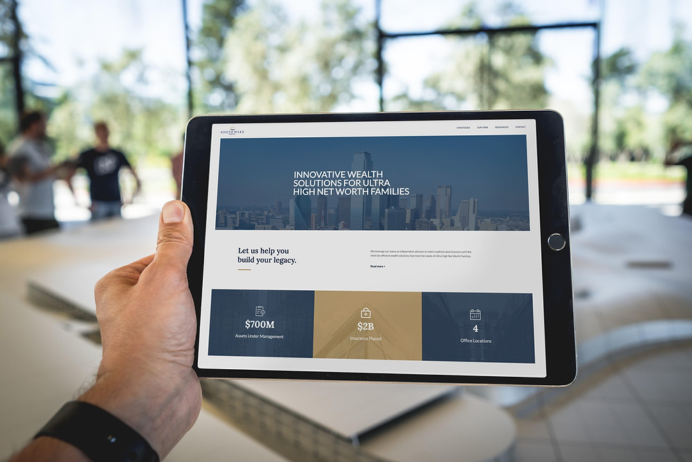 Why You Need A Modern Website Header Photo of South Wake Capital's Website on a Tablet