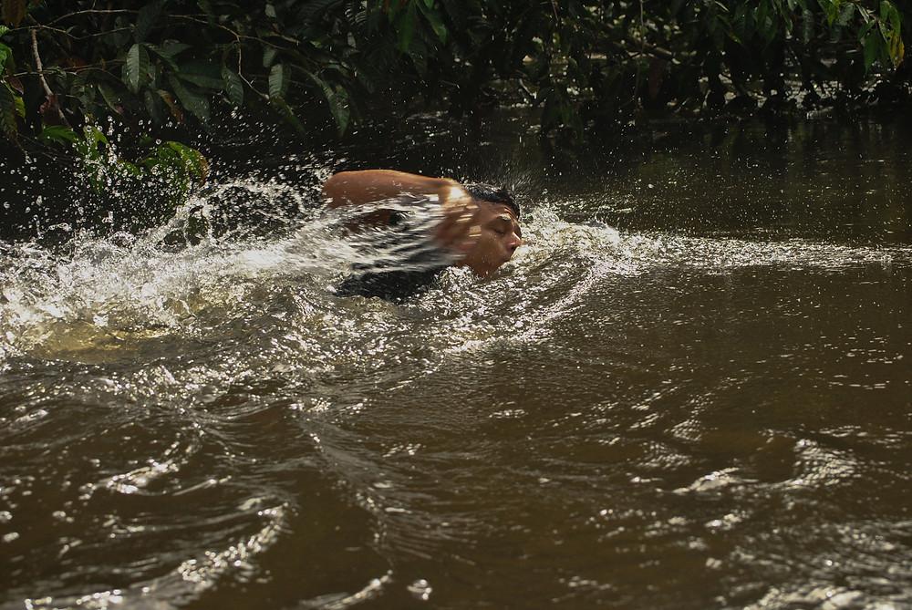 Swimming in Calderón river in the Amazon basin of COlombia