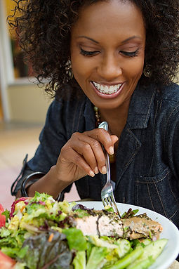 black_woman_eating_116642815.jpg