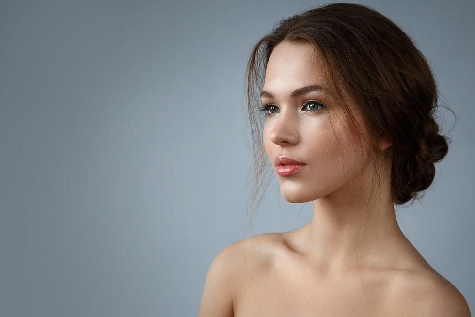 Natural looking woman on grey background