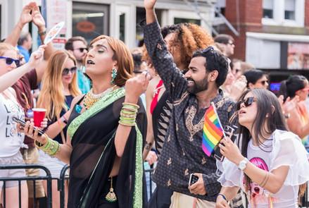 Several memebers waving at pride