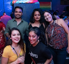 group of smiling Khushdc members at a club