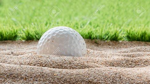 68869329-golf-ball-in-sand-bunker.jpg