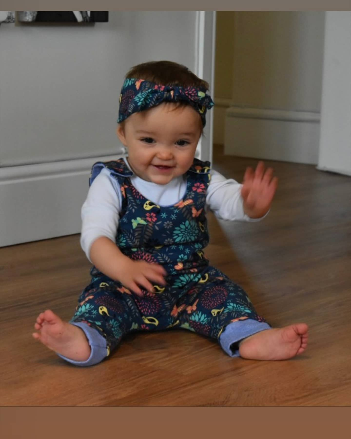 wearing our long leg romper and headband