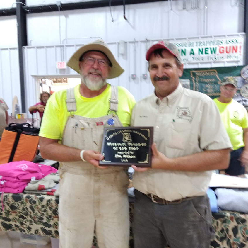 President, Clay Creech presenting Tim Wilson with the Trapper of the Year Award.