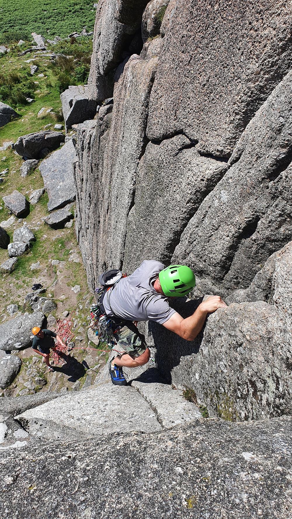Rock climber leading at Sheeps Tor