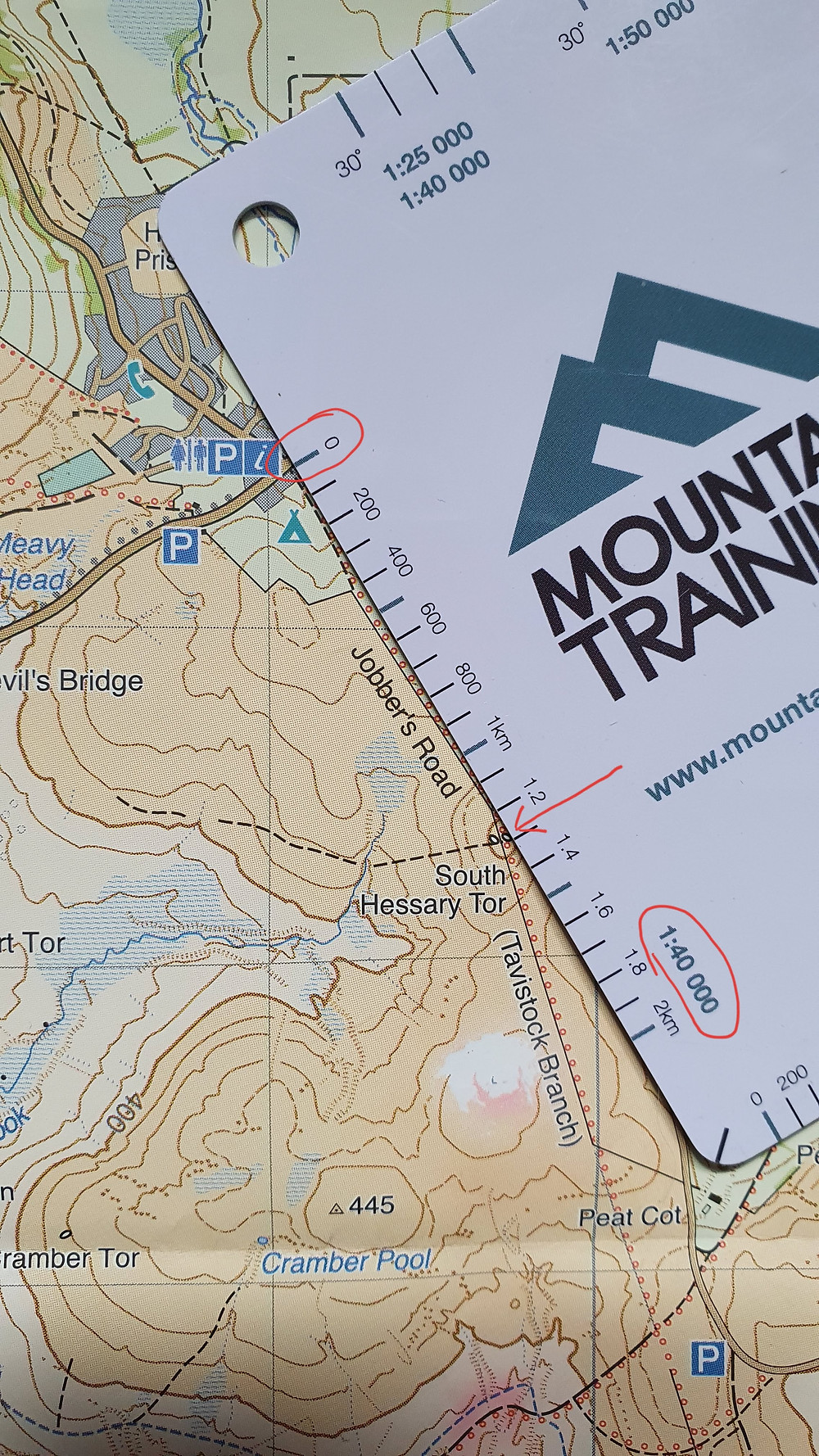 Using a distance measuring card to measure distance on a Harvey's Map