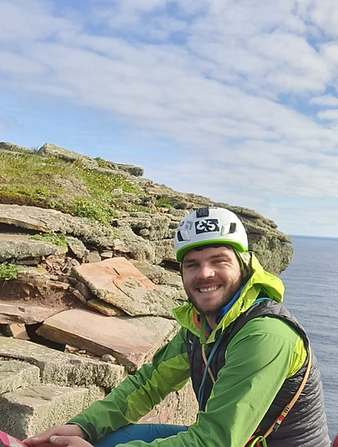 Chris Cowdrey of At The Edge Mountaineering, summit of the Old Man of Hoy
