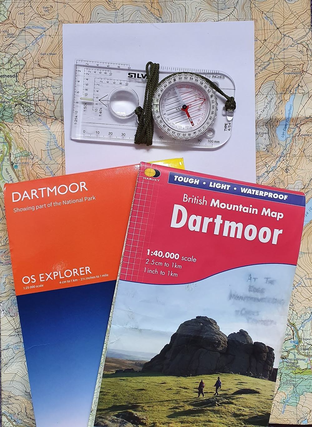 a selection of maps and a compass