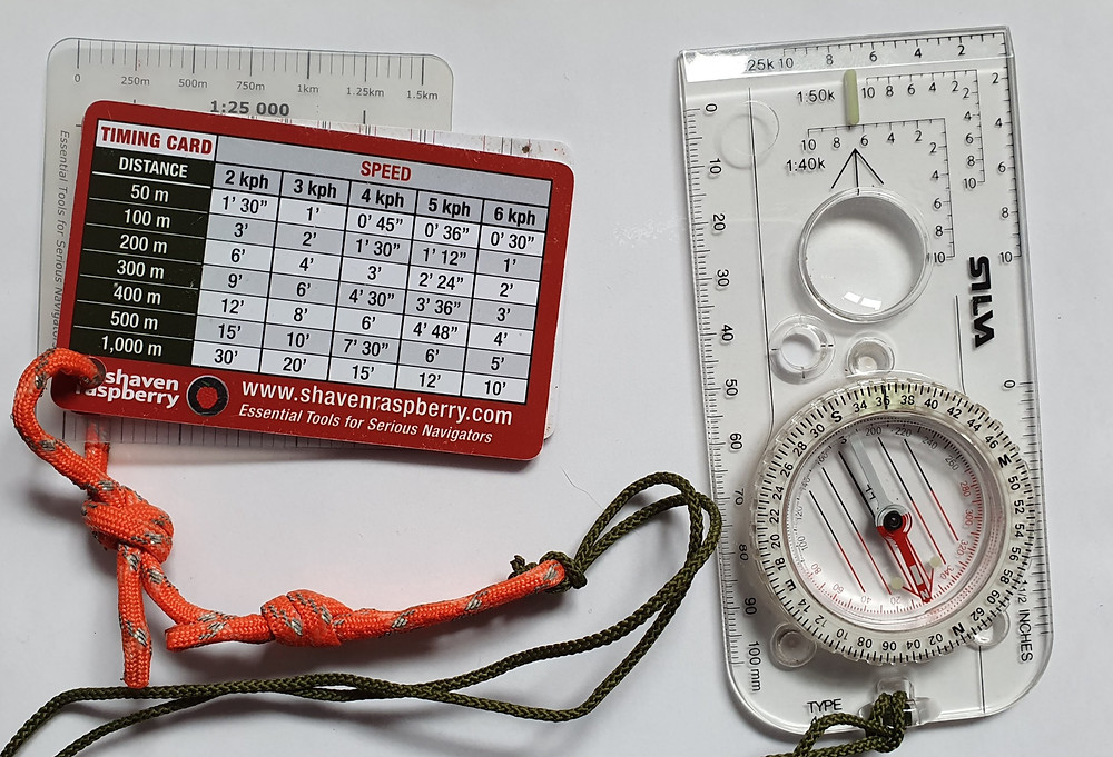 Selection of navigational aids: compass, pacing beads and timing cards