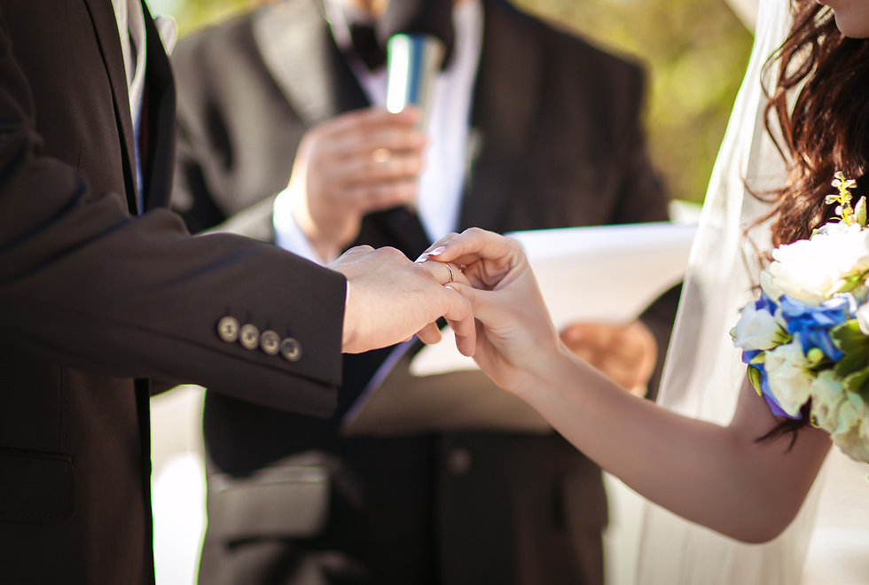 Wedding couple holding hands with rings,