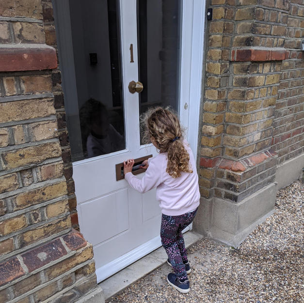 A young HARP Community Champion delivers leaflets