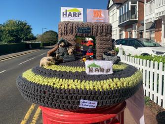 Queen of the 'Postbox Hats' Reveals the HARP hat!