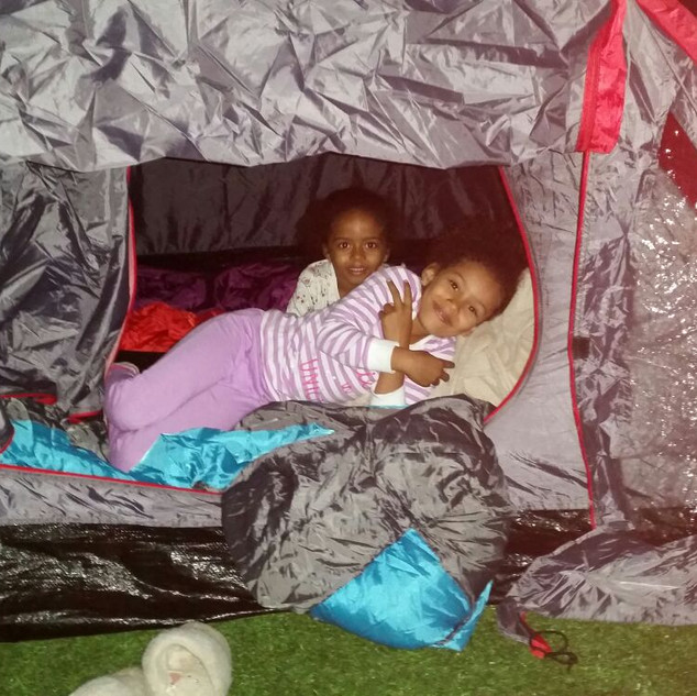 Chiara and Sofia enjoy their tent in the garden