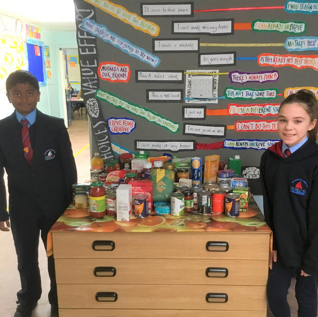 Students of Riverside Primary School proudly display their collection
