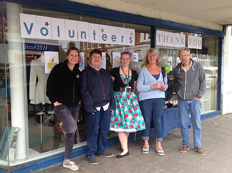 HARP staff and volunteers outside HARP shop