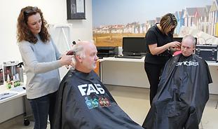 Homeless person has haircut at HARP's Bradbury Day Centre