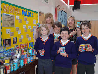 Pupils at St Georges Catholic Primary School collect for HARP!